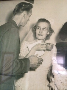 Grandma Miriam looking somewhat horrified as she sips tea (or possibly coffee) on her wedding day.